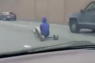 Guy Plays Real Life Mario Cart… On The Highway