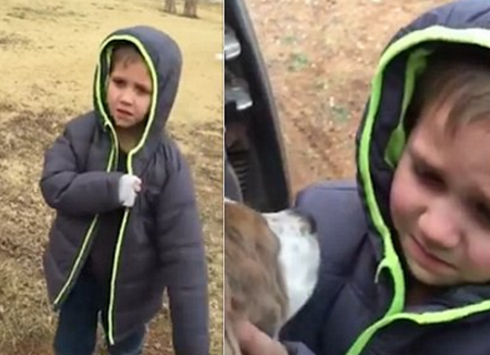Young boy bursts into tears of joy when he is reunited with his dog... missing for a month